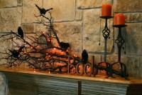 50 Awesome Halloween Decorating Ideas Black Bird on Twig and Candle