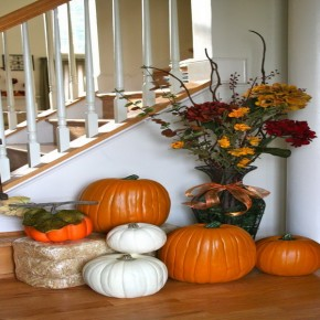 Orange and white pumpkins next to stairway axihomedesign.com