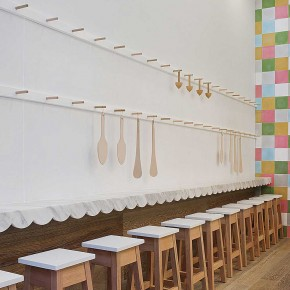 Interior Design for a Cupcake Shop long line white chair