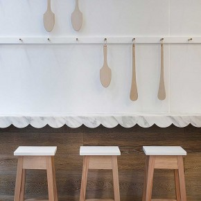 Interior Design for a Cupcake Shop white wall and chair with spoon