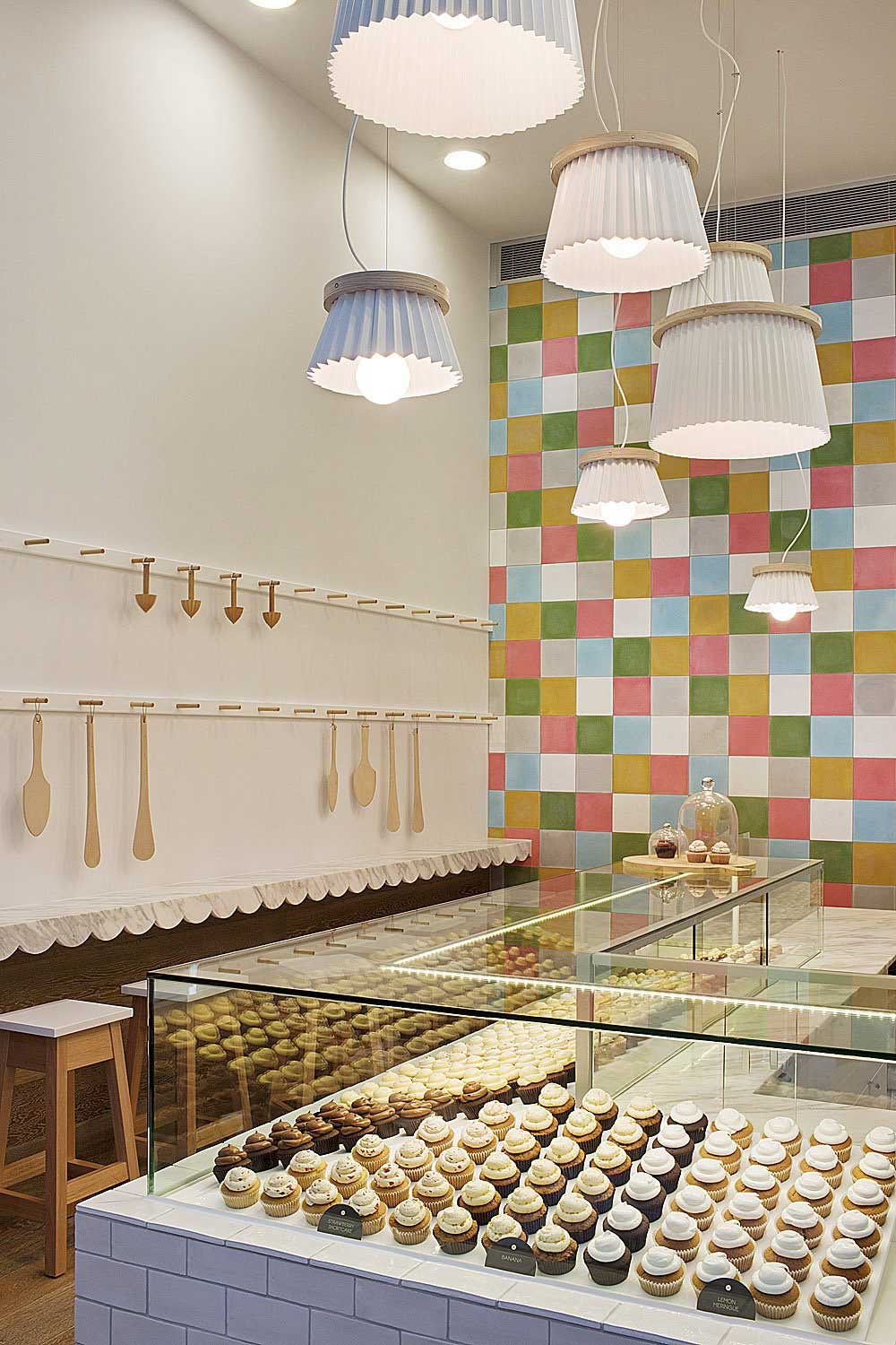 Interior Design for a Cupcake Shop with door open and glass exterior