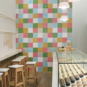 Interior Design for a Cupcake Shop with full color wallpaper and wall table