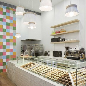Interior Design for a Cupcake Shop with glass cookies table