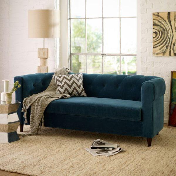 A Deep Blue Sofa In A White Living Room Interior Design