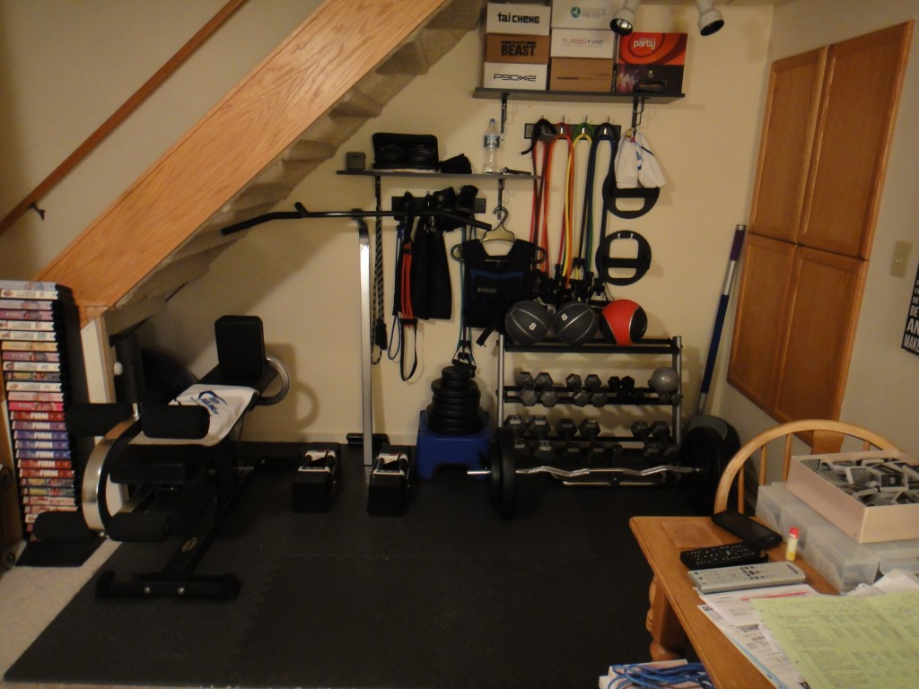 Very small home fitness room gym with black cork mats perfect ...