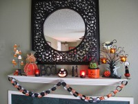 50 Awesome Halloween Decorating Ideas White Fireplace With Glass and Cute Pumpkins